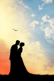 Bride and groom at sunset. Illustration of bride and groom silhouette at sunset Royalty Free Stock Images