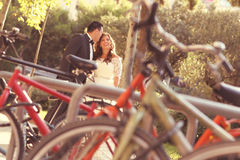 Bride and groom. Surrounded by bicycles Royalty Free Stock Image