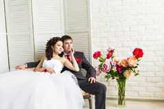 Bride and groom surrounded by flowers Stock Image