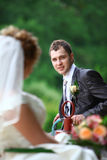Bride and groom on swing Royalty Free Stock Image