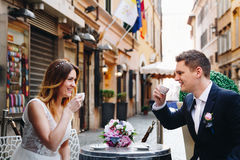 Bride and groom on a table drinking coffee in Rome, Italy Stock Photo