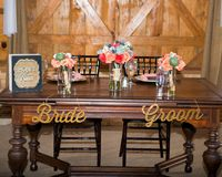 The bride and groom table at a reception stock photo
