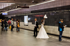 Bride and groom take wedding photos in subway royalty free stock photo