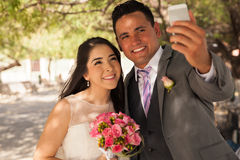 Bride and groom taking selfie Stock Photography