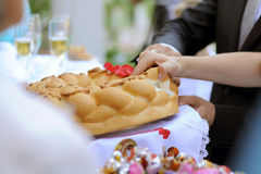 Tearing Wedding Loaf. Bride and groom tearing traditional wedding loaf Stock Photography