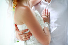 Bride and groom on their wedding day hugging Royalty Free Stock Image
