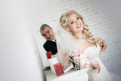 Bride an groom on their wedding day near fireplace Royalty Free Stock Photos