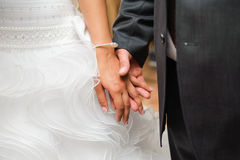 Bride and groom to hold hands. loving care Royalty Free Stock Images