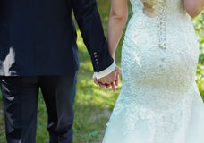 Bride and groom to hold hands. loving care Stock Photo