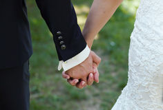 Bride and groom to hold hands. loving care Royalty Free Stock Photo