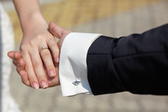 Bride and groom to hold hands. loving care Stock Images
