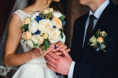 Bride and groom to stay together for background of bouquet Stock Photo