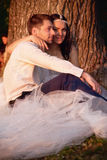Bride and groom together on a background sunset stock photos
