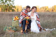 Bride and groom together with their little dog. Romantic autumn Stock Images