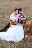Bride and groom together with their little dog. Romantic autumn Stock Photography