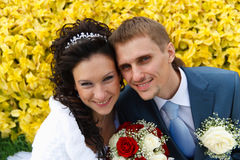 Bride and Groom together with Wedding bouquet Royalty Free Stock Photo