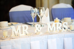 Bride and groom top table. Mr & Mrs decoration on wedding reception table Stock Photos