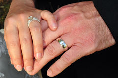 Bride and groom touching hands Royalty Free Stock Photo