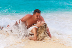 Bride and Groom on tropical beach shore in the wave Stock Photo