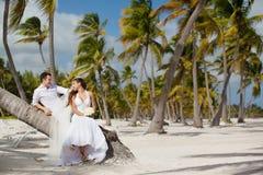 Bride and groom on a tropical beach Stock Photos