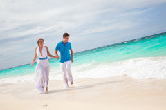 Bride and groom on beach royalty free stock photos