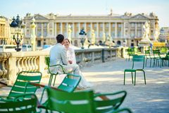 Bride and groom in the Tuileries garden of Paris Royalty Free Stock Photography
