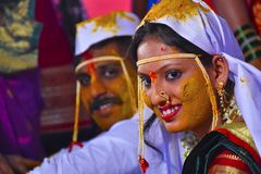 Bride and groom at turmeric ceremony at Indian wedding royalty free stock images