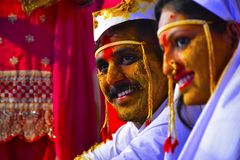 Bride and groom at turmeric ceremony at Indian wedding stock images