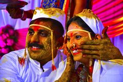 Bride and groom at turmeric ceremony at Indian wedding royalty free stock photos