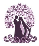 Bride and groom. Under arbor with filigree coil below Royalty Free Stock Image