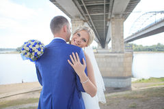Bride and groom. Under a bridge stock image