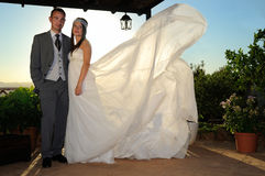 Bride and groom under a porch full length Stock Images