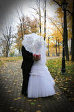 Bride and groom under umbrella Royalty Free Stock Photo