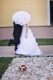 Bride and groom under umbrella Royalty Free Stock Photography
