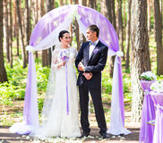 Bride and Groom Under wedding arch. Stock Image