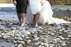 Bride and groom with unshod feet Royalty Free Stock Photo