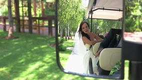 Bride and groom in vehicle. stock footage
