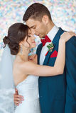Bride and groom in very bright colored room Stock Images