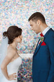 Bride and groom in very bright colored room Royalty Free Stock Photo
