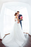 Bride and groom in very bright room at home Royalty Free Stock Photography