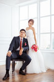Bride and groom in very bright room Royalty Free Stock Images