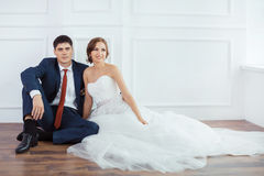 Bride and groom in very bright room Stock Photo