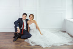 Bride and groom in very bright room Stock Image
