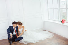 Bride and groom in very bright room Royalty Free Stock Image