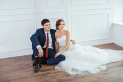 Bride and groom in very bright room Stock Photos