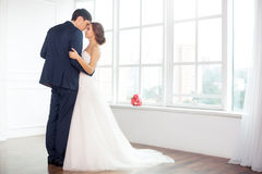 Bride and groom in very bright room Royalty Free Stock Photos