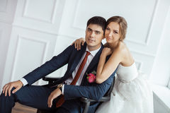 Bride and groom in very bright room Stock Images