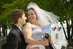 Bride and Groom by Viewfinder. A Bride and Groom near a Viewfinder in a forest setting royalty free stock photo
