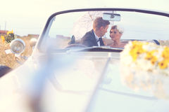 Bride and groom in a vintage car Royalty Free Stock Image