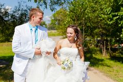 Bride and groom walk Stock Photography